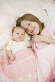 Mother and her bay lying together Stock Images