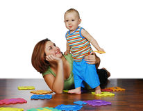 Mother and her child. The mother is playing with her child Stock Photos