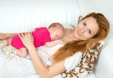 Mother and her child baby sleeping lying on her stomach Royalty Free Stock Image