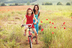 Mother with her child on bicycle Royalty Free Stock Photography