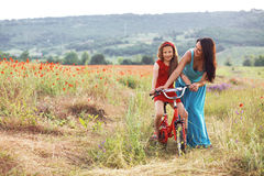Mother with her child on bicycle Stock Images