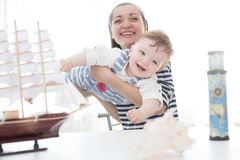 Mother and her child boy making model ship. Stock Photo