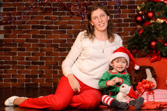 Mother and her child in christmas interior Royalty Free Stock Photography