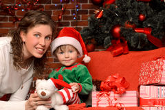 Mother and her child in christmas interior Stock Photography