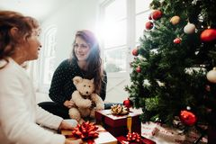 Family celebrating Christmas with lots of gifts. Stock Photo
