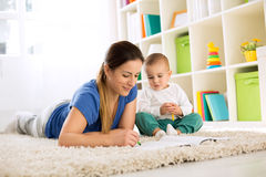 Mother with her child drawing with wax colors Stock Photo