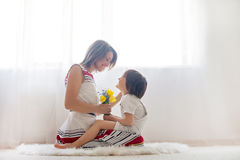 Mother and her child, embracing with tenderness and care Royalty Free Stock Photo