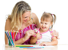 Mother and her child fun games with color pencils Stock Images