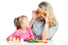 Mother and her child fun games with colorful toy Stock Photo