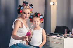 Mother and her child girl are doing your makeup and having fun Royalty Free Stock Photography
