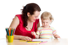 Mother and her child girl pencil together Stock Photo