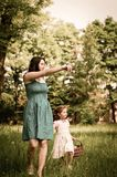 Mother with her child having great time outdoors Stock Photos