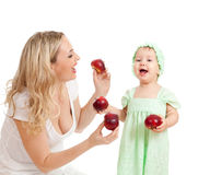 Mother and her child with healthy food. Mother and her child with red apples Stock Images