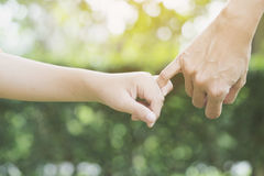 A mother and her child hooking their fingers Royalty Free Stock Images