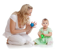 Mother and her child massage with rubber devices. Mother and her child massage with rubber balls Royalty Free Stock Photo