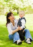 Mother with her child outdoors royalty free stock image