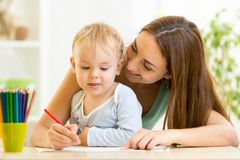 Mother and her child pencil together Royalty Free Stock Photos
