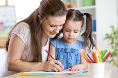Mother and her child pencil together Royalty Free Stock Photography