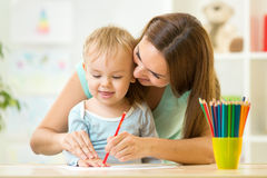 Mother and her child pencil together Royalty Free Stock Photo