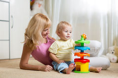 Mother and her child playing with colorful logical Stock Photo