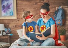 Girl and mom in Superhero costume Royalty Free Stock Image