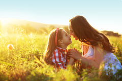 Mother with her child in spring field Royalty Free Stock Image