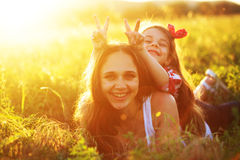 Mother with her child in spring field Royalty Free Stock Images