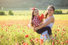 Mother with her child in spring field Royalty Free Stock Photography