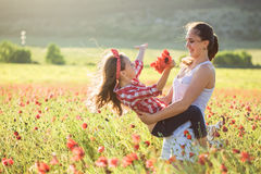 Mother with her child in spring field Stock Photos