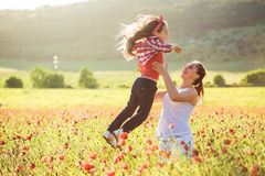 Mother with her child in spring field Stock Photography