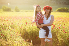 Mother with her child in spring field Royalty Free Stock Photos