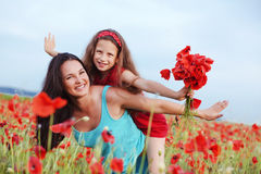 Mother with her child in spring field Stock Images