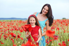 Mother with her child in spring field Stock Photo