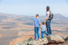 Mother and her child standing on cliff's edge Royalty Free Stock Photography