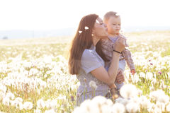 Mother with her child in sunlight Stock Photos