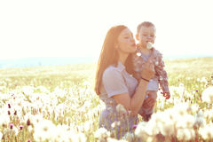 Mother with her child in sunlight Royalty Free Stock Image