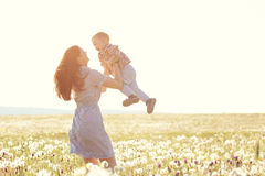 Mother with her child in sunlight Stock Photography