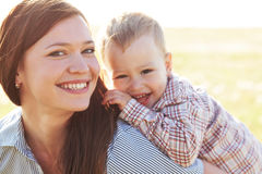 Mother with her child in sunlight Stock Image