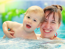Mother with her child in swimming-pool Royalty Free Stock Images