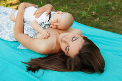 Mother with her child take rest Stock Photography
