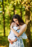 Mother with her child take rest Stock Photos