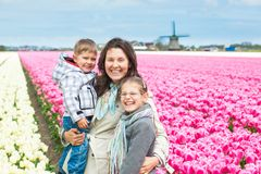 Mother with her child in tulips field Royalty Free Stock Photo