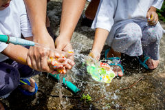 Mother and her child washing hands together after painted Stock Photos