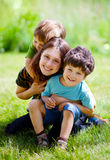 Mother with her children. Mother with children having a fun in summer park Stock Images