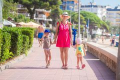 Mother with her children go to sea beach during tropical rest stock photos