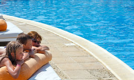 Mother with her children near swimming pool. Royalty Free Stock Photos