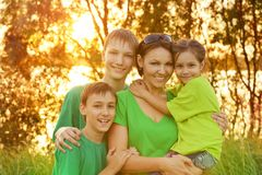 Mother with her children outdoors Stock Images
