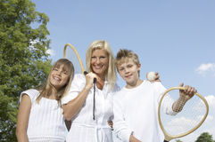 Mother with her children. Mother with her children outside with tennis rackets stock photos