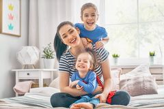 Mother and her children playing together royalty free stock photos