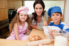 Mother and her children preparing cookies Royalty Free Stock Image